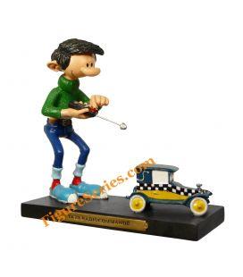 Figurine GASTON LAGAFFE et le taxi FIAT 509 téléguidé